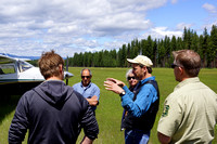Passengers discuss forest management at Condon Airstrip